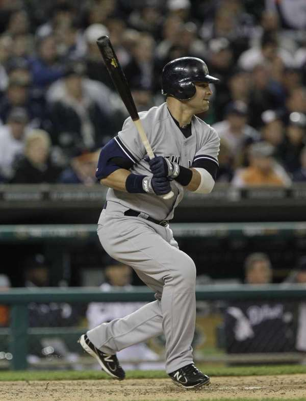 The Yankees' Nick Swisher drives in the go-ahead