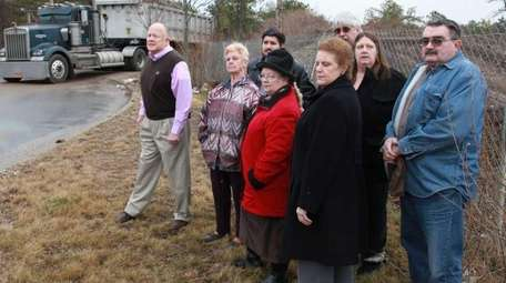 Members of local civic organizations at the site