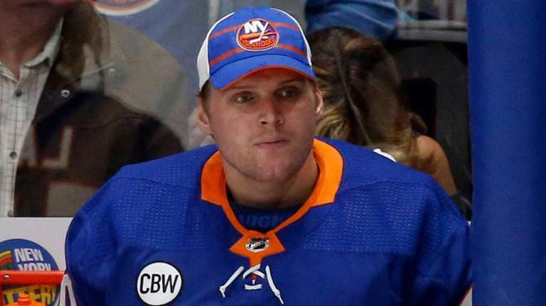Islanders goalie Robin Lehner looks on from the