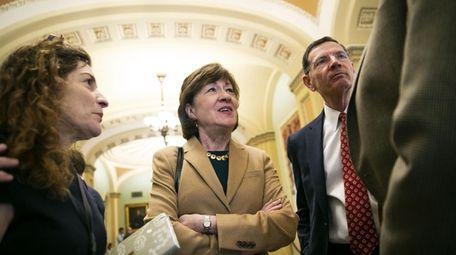 Sen. Susan Collins, center, of Maine is one