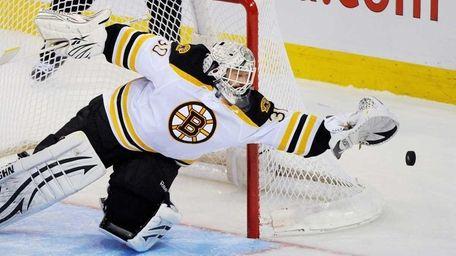Boston Bruins' goaltender Tim Thomas makes a save
