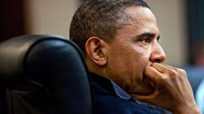 President Barack Obama listens during a raid that