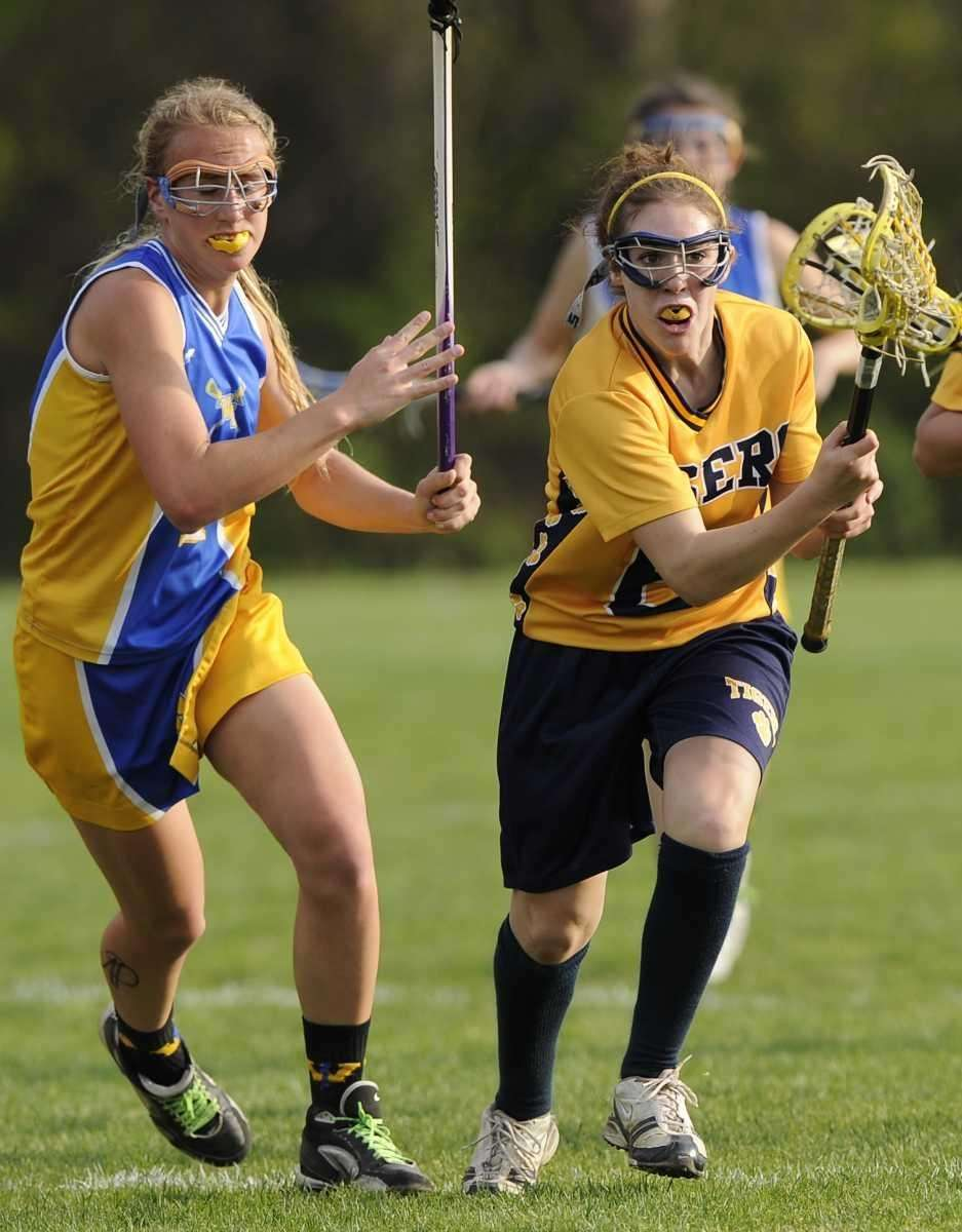 Northport's Paige Bonomi is pursued by West Islip's