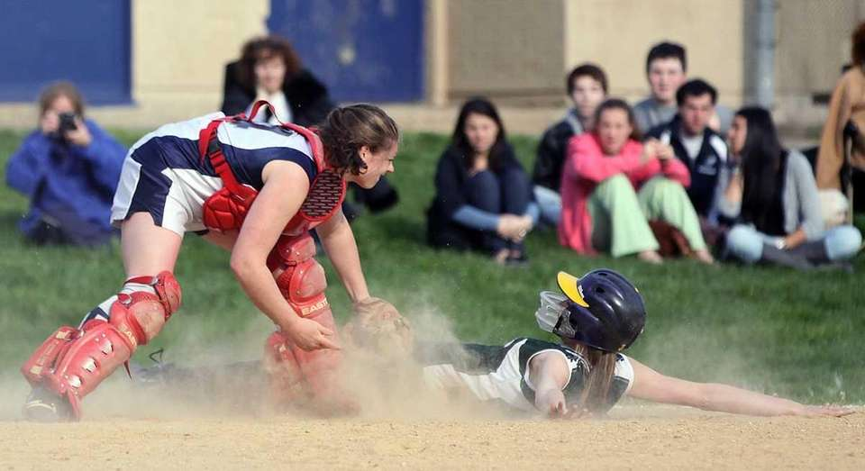 JFK's Lauren Sustad is safe under the tag