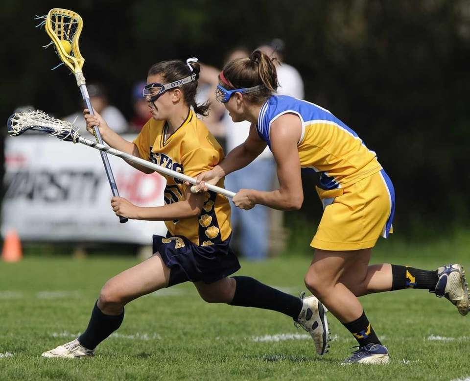 Northport attacker Cortney Fortunato is defended by West