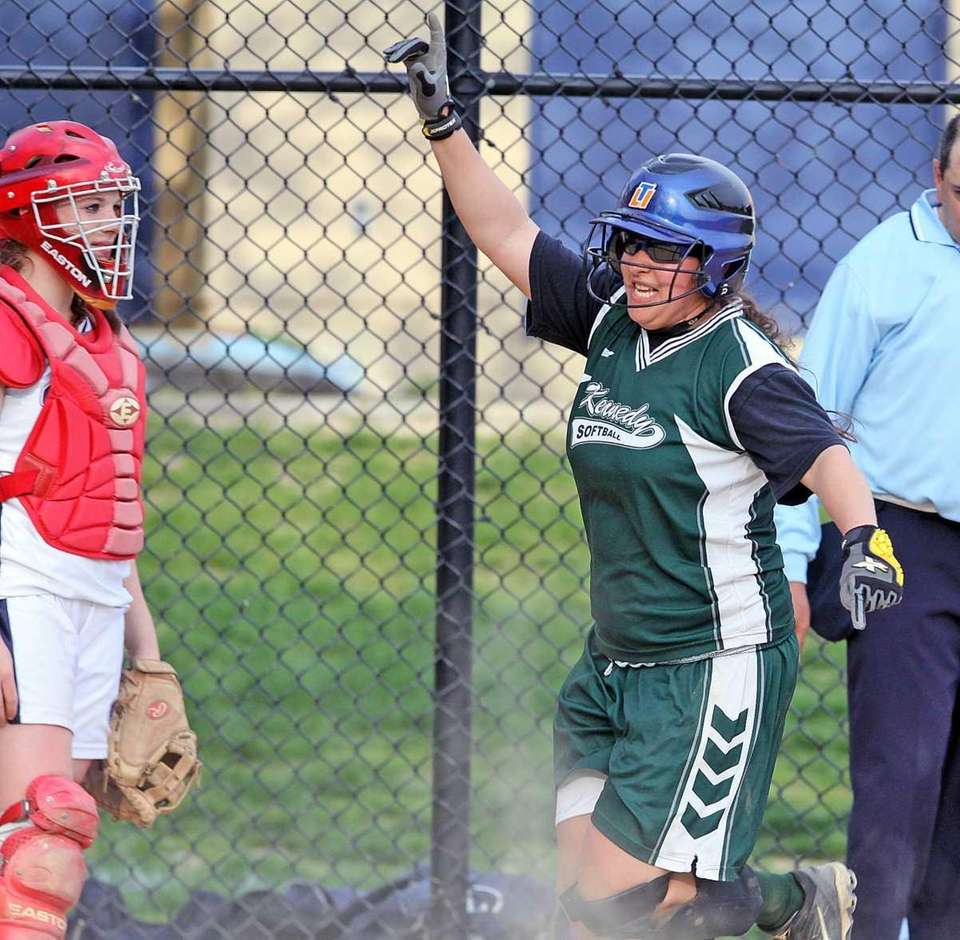 JFK's Carly Thea scores the winning run in