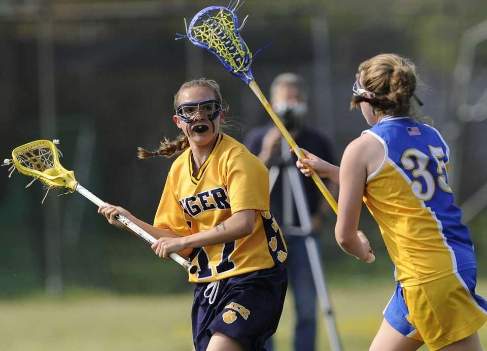 Northport midfielder Erin Magnuson is defended by West
