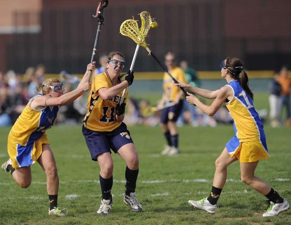 Northport midfielder Shannon Gilroy is defended by West