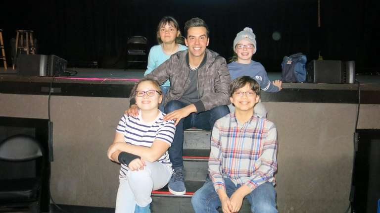 Actor and magician Michael Carbonaro with Kidsday reporters
