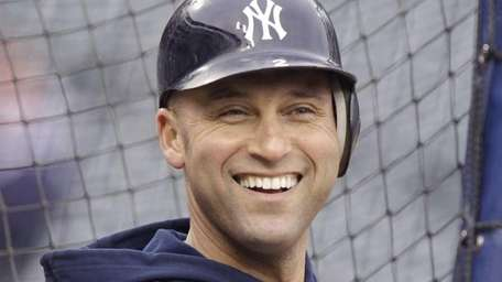 New York Yankees shortstop Derek Jeter smiles during