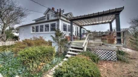 This Oak Beach home is listed for $649,717.