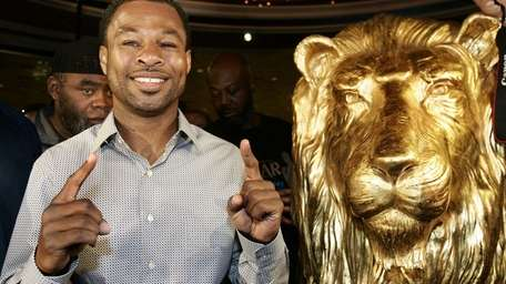 Shane Mosley poses for a photo at the