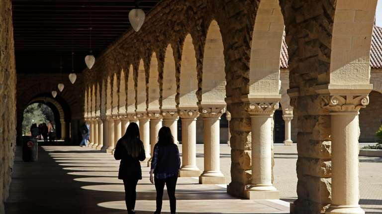 Students walk on the Stanford University campus on