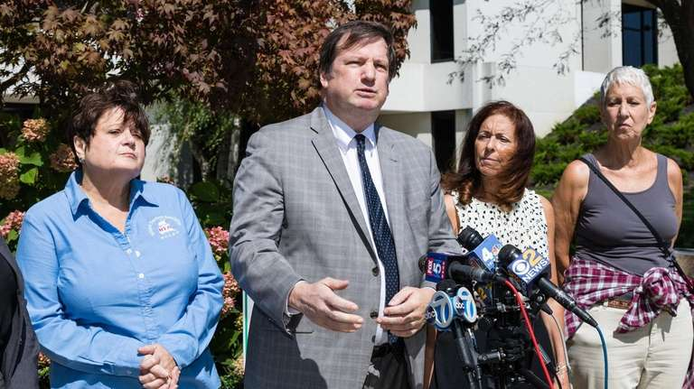 Attorney Christopher Murray, second from left, and Adrienne