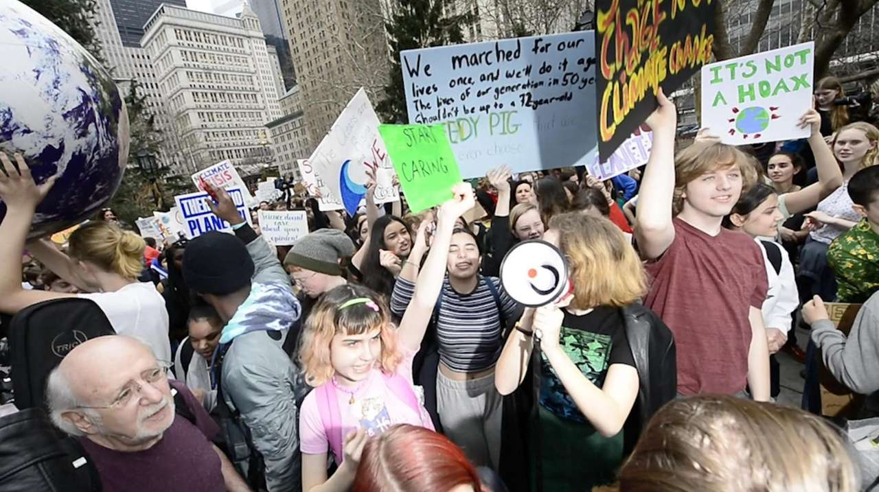 Children from Youth Climate Strikes gathered Friday at