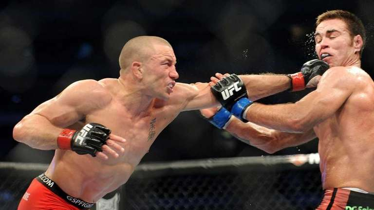 Georges St-Pierre, left, battles against Jake Shields during