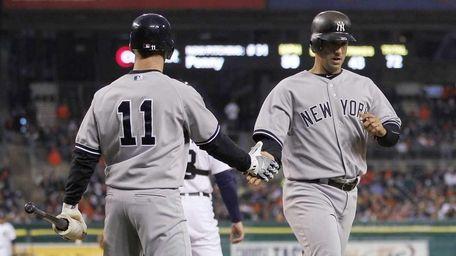 The Yankees' Jorge Posada celebrates with Brett Gardner