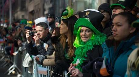 Spectators watch the St. Patrick's Day Parade on