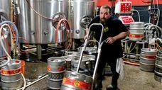 A worker inside Barrier Brewing Co. in Oceanside,