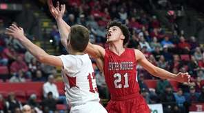 Center Moriches' Sean Braithwaite, right, reaches for a