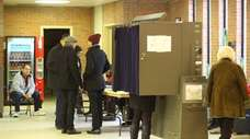 Voters cast their ballots at the Freeport Recreation