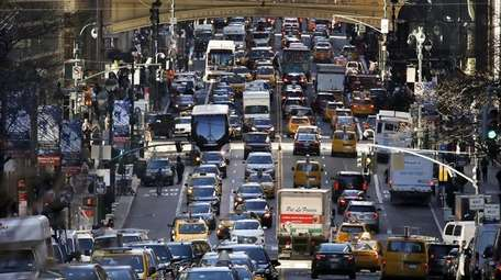 Traffic fills 42nd Street in midtown Manhattan on