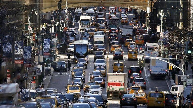 Traffic fills 42nd Street in midtown Manhattan on
