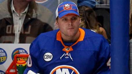 Robin Lehner of the Islanders looks on from