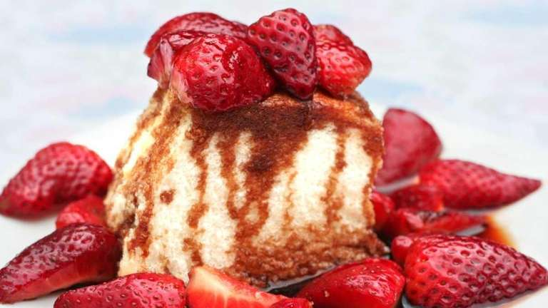 Angel food cake with balsamic macerated strawberries.