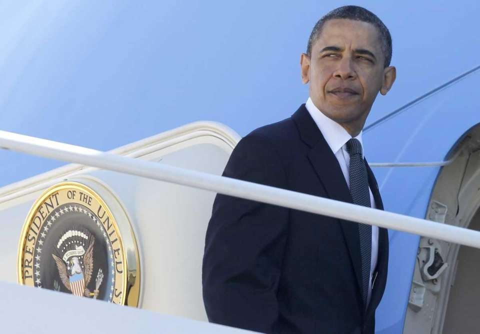 President Barack Obama boards Air Force One at