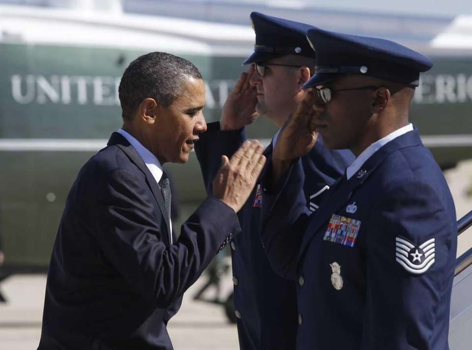 President Obama salutes as he boards Air Force