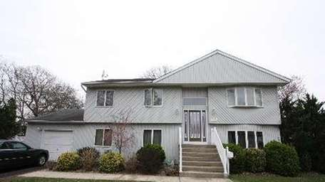 This West Babylon high-ranch, listed at $439,990, has