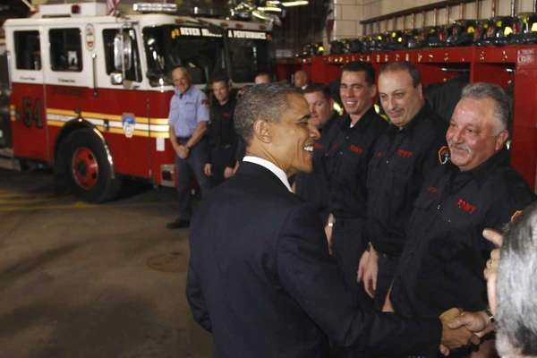 President Barack Obama meets with firefighters and first