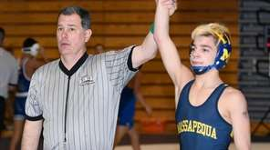 Massapequa's Anthony Conetta wins his bout against Bellmore