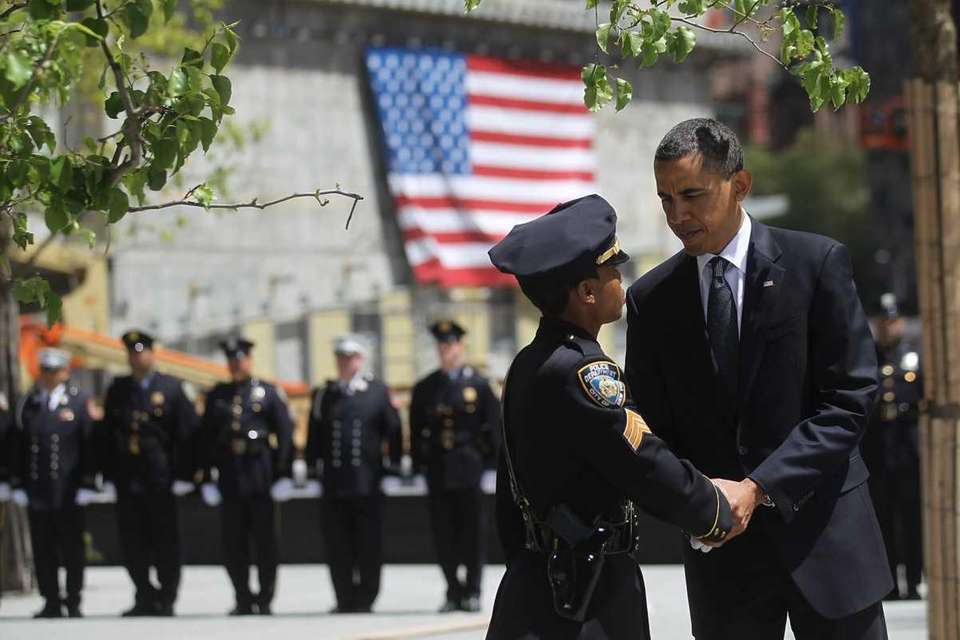 President Obama shakes hands with a New York