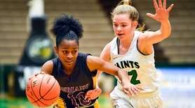 Sewanhaka's Flo Hunte (10) moves the ball against