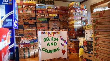 Donated food items are stacked high inside the