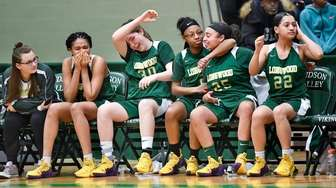 Longwood players react to a 68-54 loss to