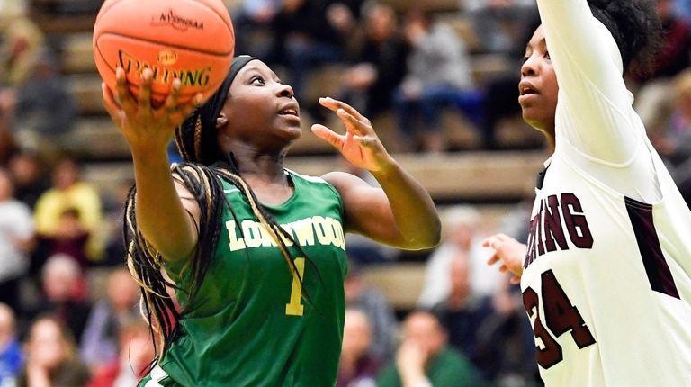 Longwood's Kanesha Strider scores against Ossining's Kailah Harris