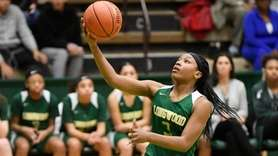Longwood's Janelle Brown (3) scores after stealing the