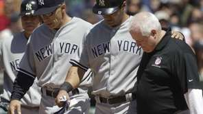 New York Yankees Eric Chavez is helped off