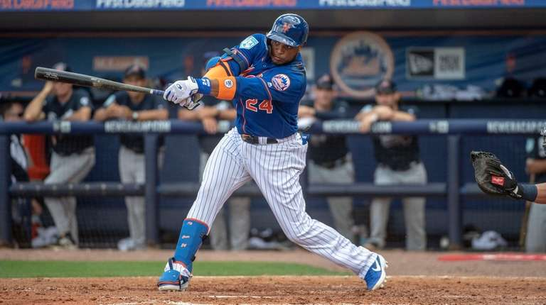 New York Mets' Robinson Cano swings during a