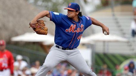 Mets starting pitcher Jason Vargas throws during the