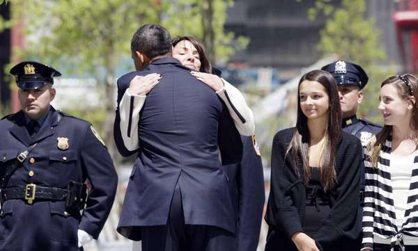 President Barack Obama greets families of victims of