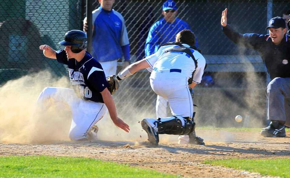 Eastport's Dave Griffiths (10) scores on a hit