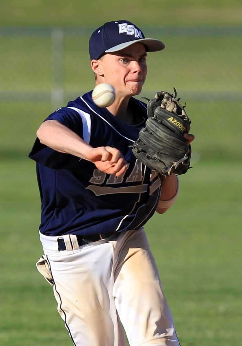Eastport shortstop Mike Flynn (11) throws out CJ