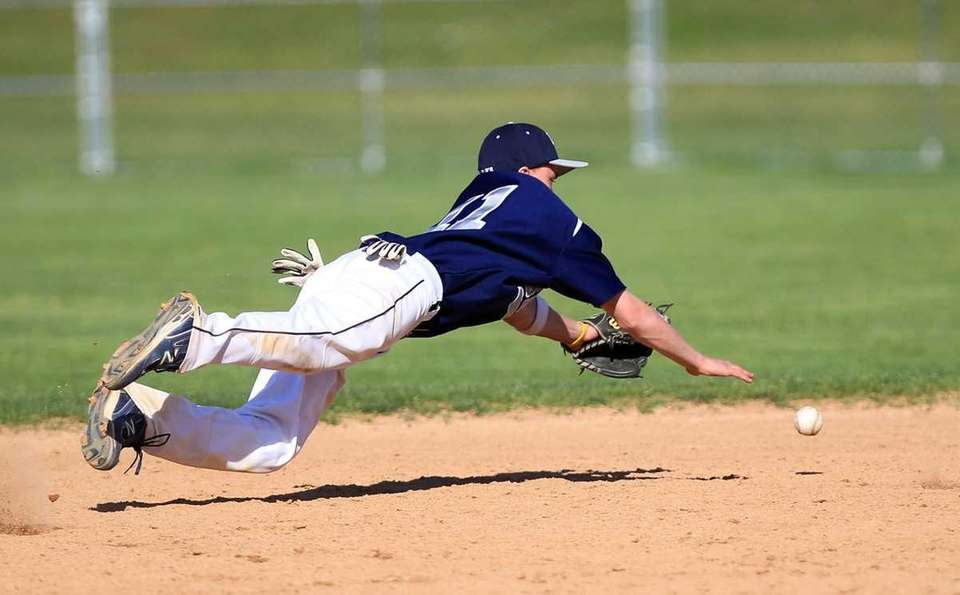 Eastport shortstop Mike Flynn (11) dives for a