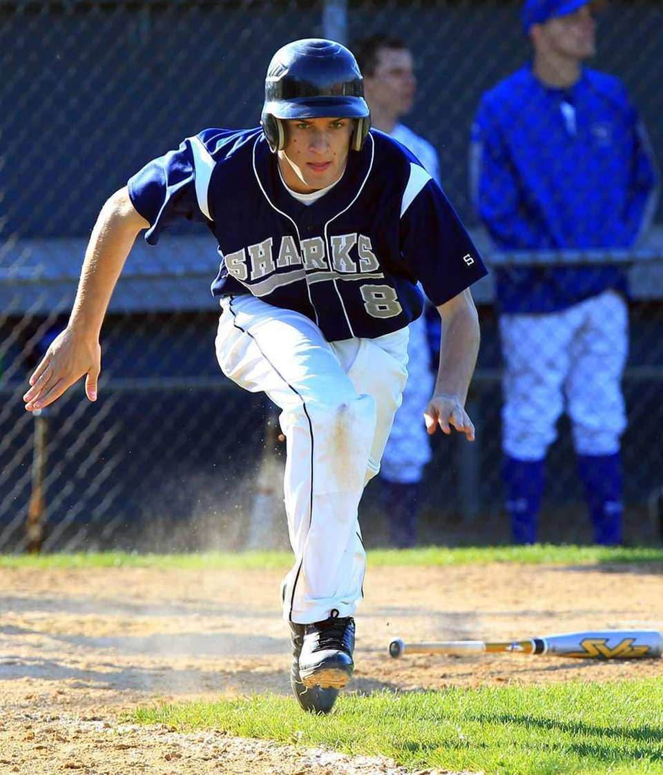 Eastport's Andrew Wysocki (8) starts for first after