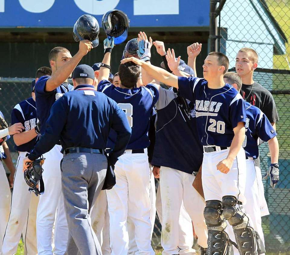 Eastport's Mat Annunziata (3) is congratulated by teammates