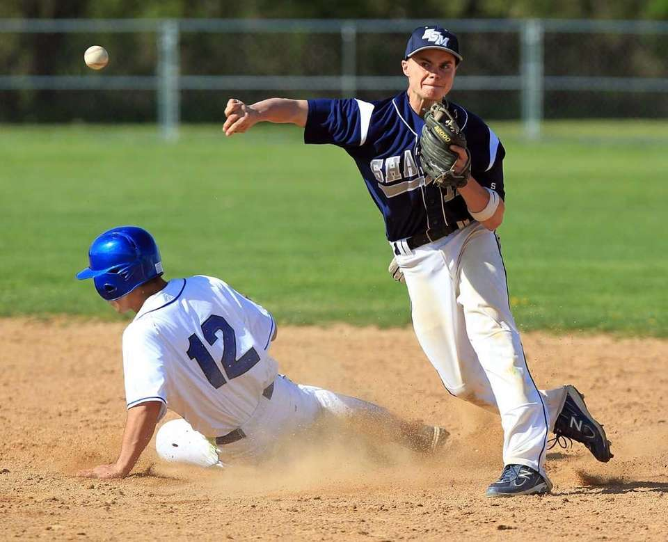 Eastport shortstop Mike Flynn (11) gets Hauppauge's Joe